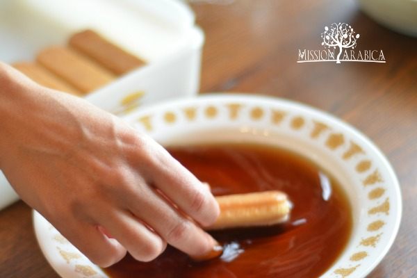 dipping lady fingers in coffee